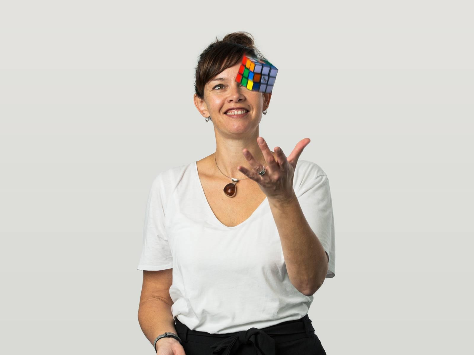 Ana catching a Rubix cube