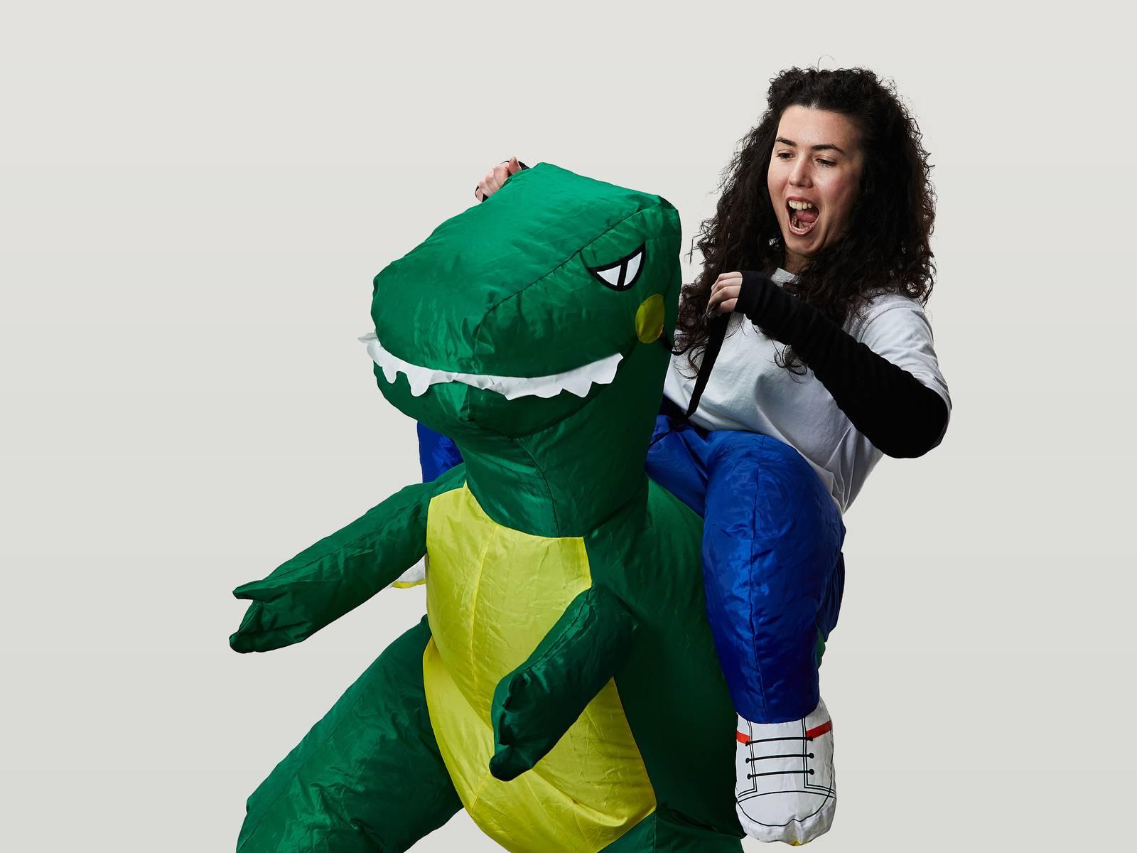 Emma riding a dinosaur
