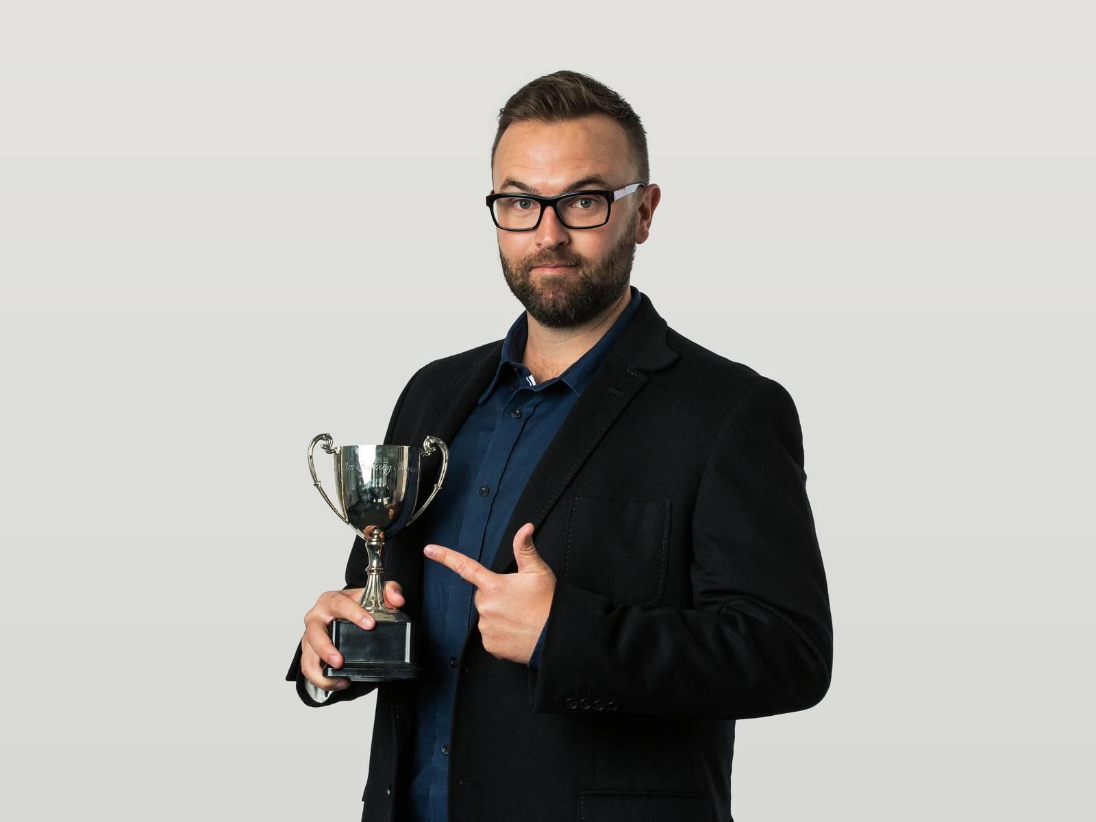 Jonny holding a trophy