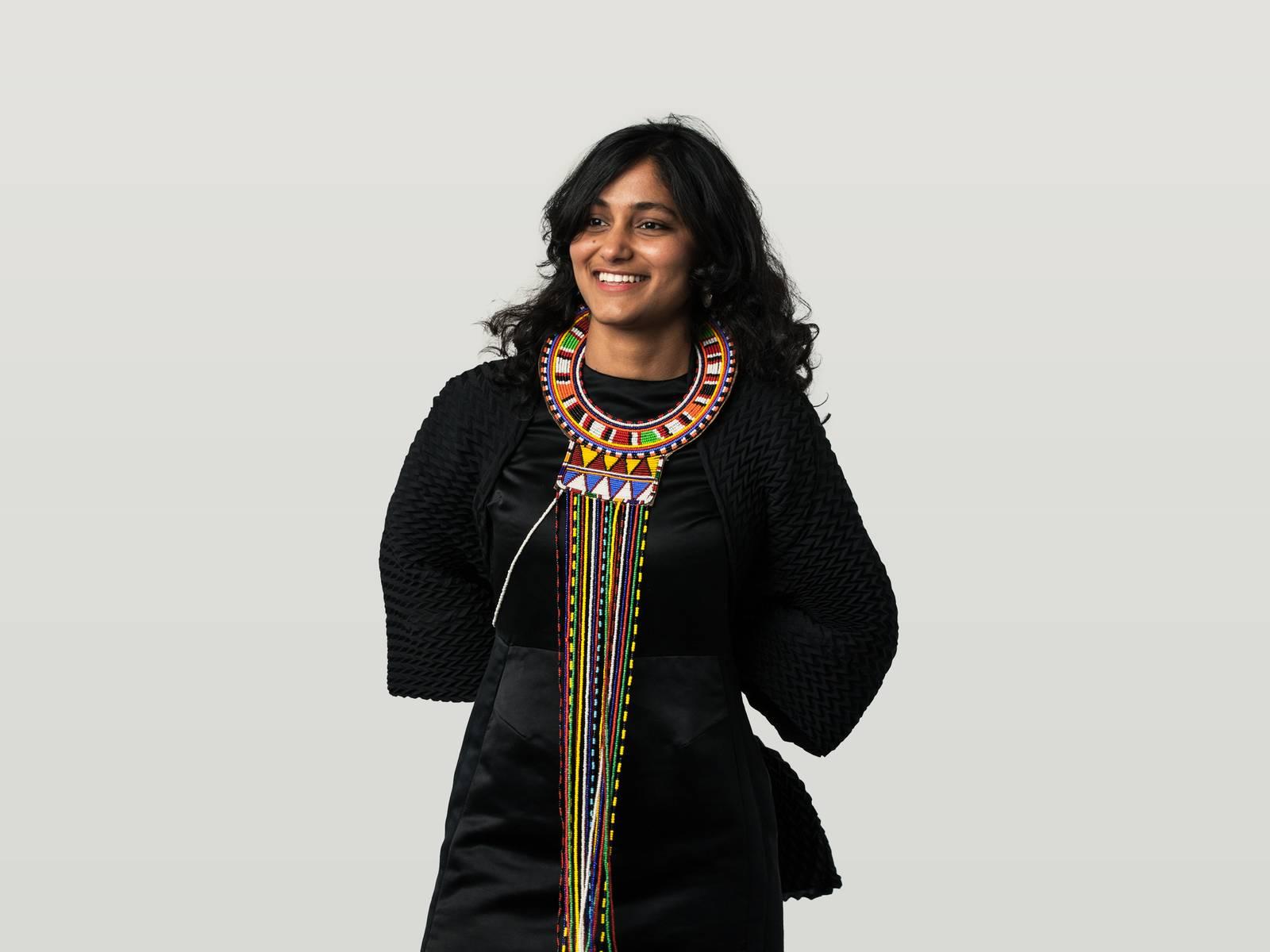 Kanhika, wearing a traditional colourful beaded maasai necklace from Kenya