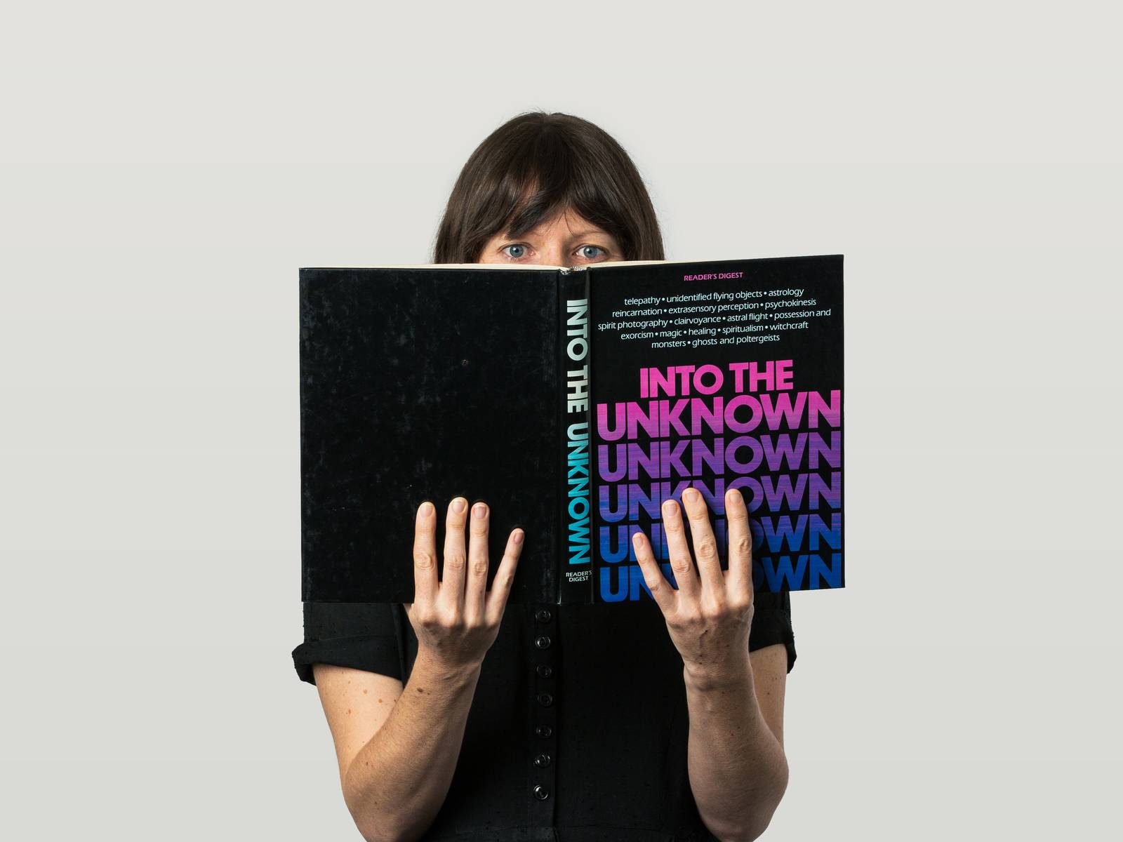 Lizy reading 'Into The Unknown' book