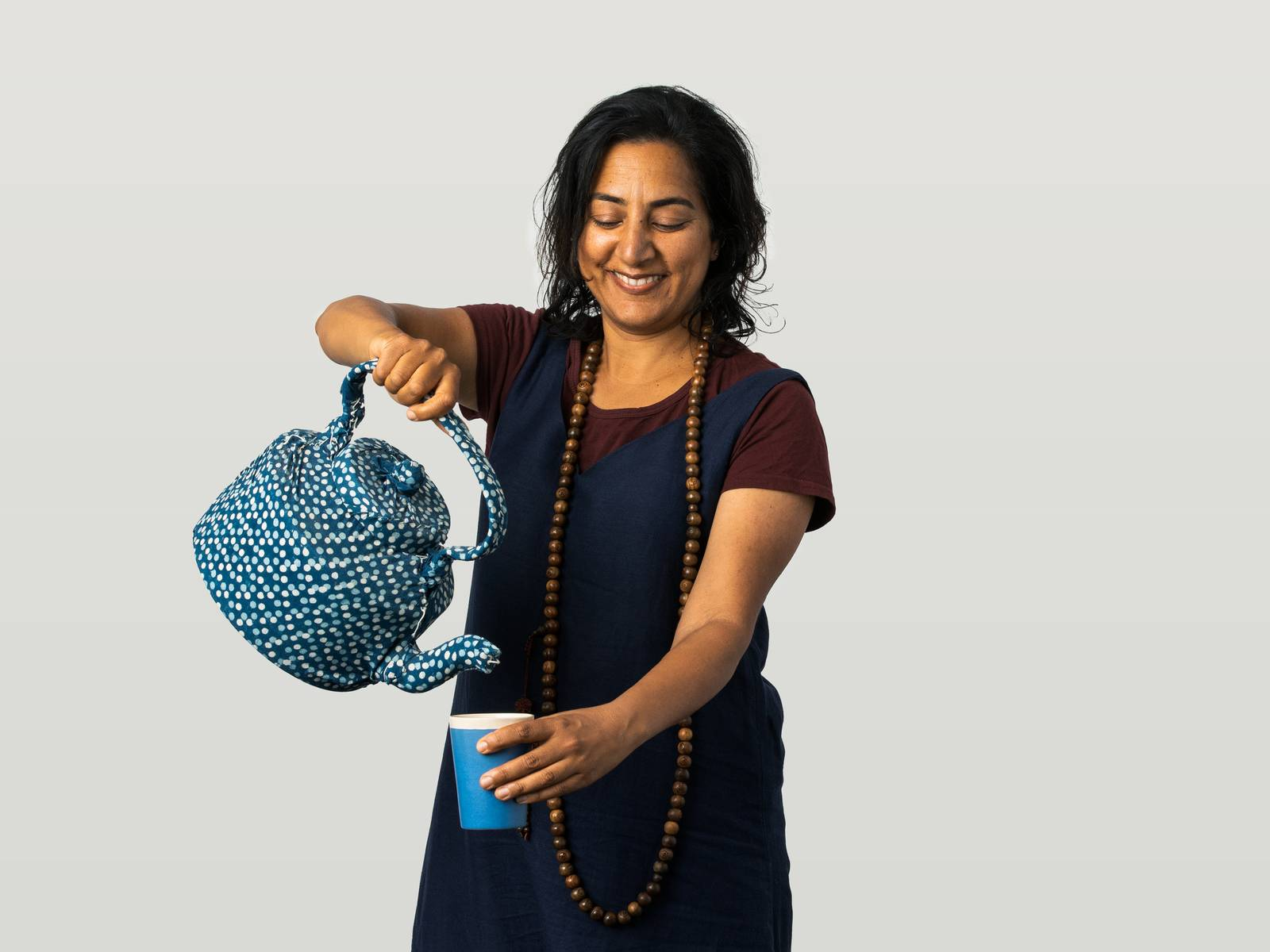 Meena pouring a cup of tea