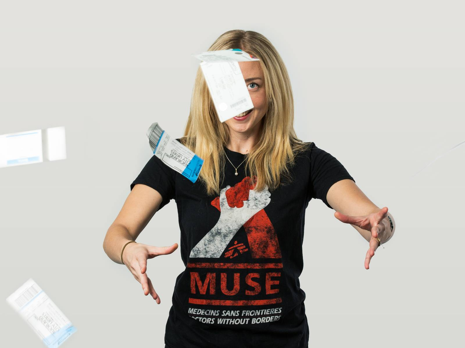 Michelle in a Muse t-shirt and throwing gig tickets in the air