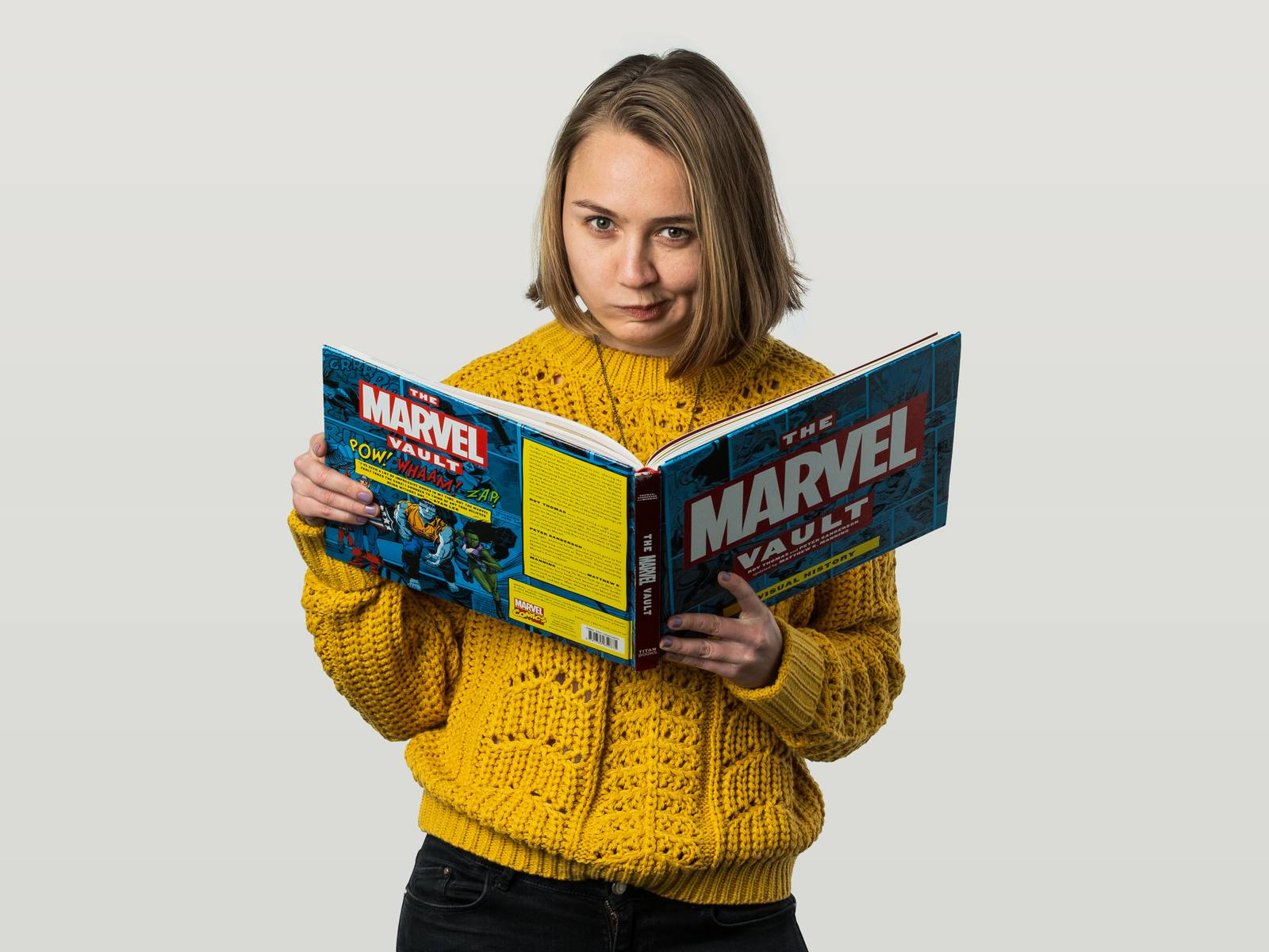 Sofia reading 'The Marvel Vault'