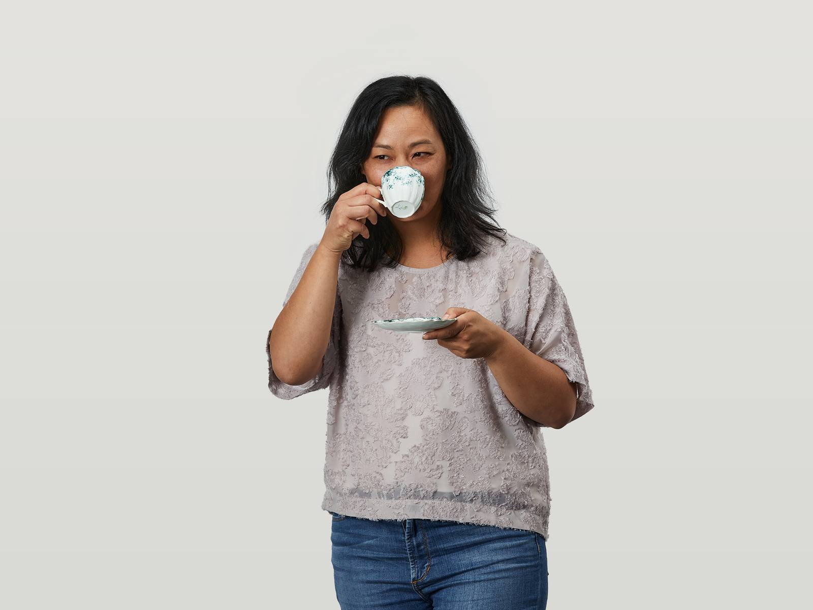 Stephanie sipping a cup of tea